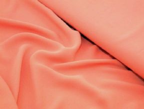 Salmon pink georgette dressmaking fabric